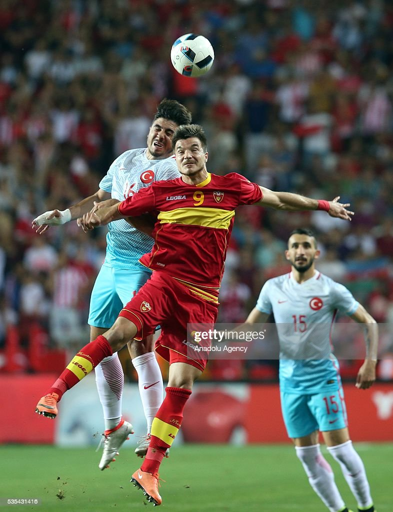 Ozan Tufan (L) of Turkey and Stefan Mugosa (C) of Montenegro vie for the ball during the friendly football match between Turkey and Montenegro at Antalya Ataturk Stadium in Antalya, Turkey on May 29, 2016.