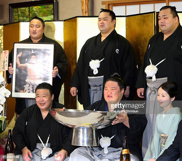 Ozeki Goeido celebrates winning the tournament after final day of the Grand Sumo Autumn Tournament at Sakaigawa Stable on September 25 2016 in Tokyo...