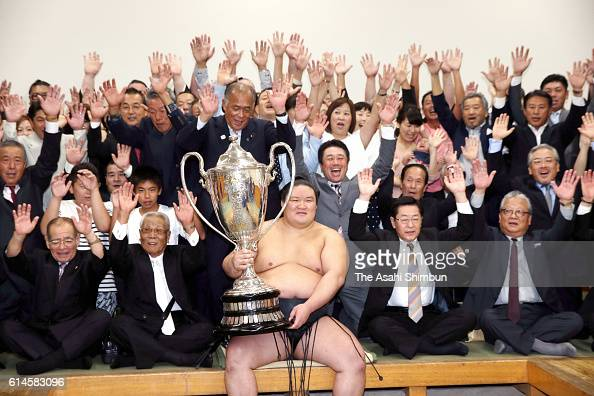 Ozeki Goeido celebrates with his supporters in the dressing room after winning the tournament during final day of the Grand Sumo Autumn Tournament at...