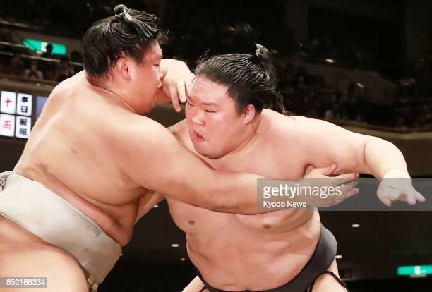 Ozeki Goeido defeats ninthranked maegashira Takanoiwa at Tokyo's Ryogoku Kokugikan on Sept 23 the 14th day of the 15day Autumn Grand Sumo Tournament...