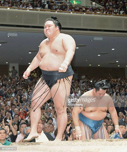Ozeki Goeido defeats sixthranked maegashira Tamawashi at the Autumn Grand Sumo Tournament in Tokyo on Sept 24 capturing his first Emperor's Cup title...