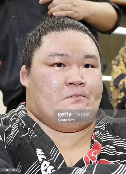 Ozeki Goeido meets with reporters in his dressing room after capturing his first Emperor's Cup title by defeating sixthranked maegashira Tamawashi at...