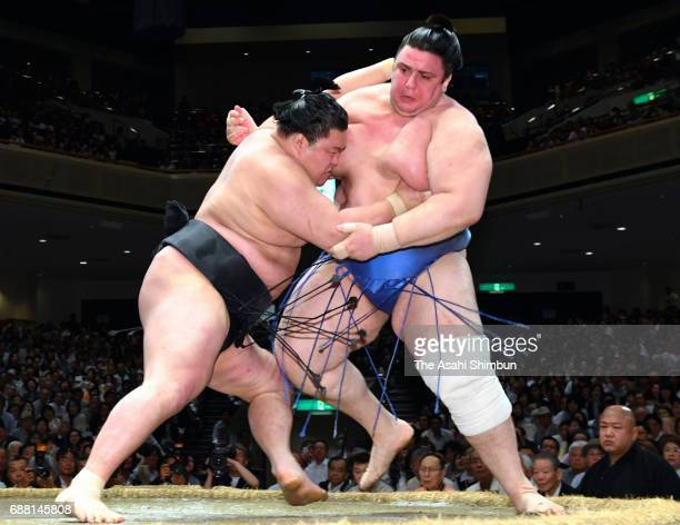 Ozeki Goeido pushes Bulgarian wrestler Aoiyama out of the ring to win during day twelve of the Grand Sumo Summer Tournament at Ryogoku Kokugikan on...