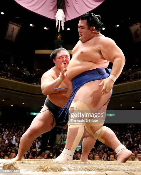 Ozeki Goeido pushes ozeki Kotoshogiku out of the ring to win during final day of the Grand Sumo Autumn Tournament at Ryogoku Kokugikan on September...