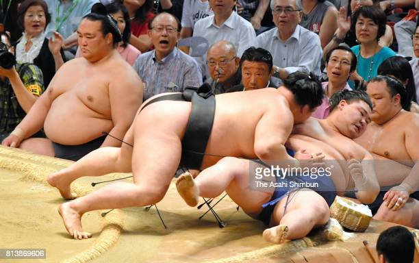 Ozeki Goeido pushes Shodai out of the ring to win during day five of the Grand Sumo Nagoya Torunament at Aichi Prefecture Gymnasium on July 13 2017...