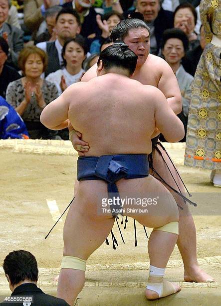 Ozeki Goeido pushes Takarafuji out of the ring to win during day one of the Grand Sumo Spring Tournament at Bodymaker Colosseum on March 8 2015 in...