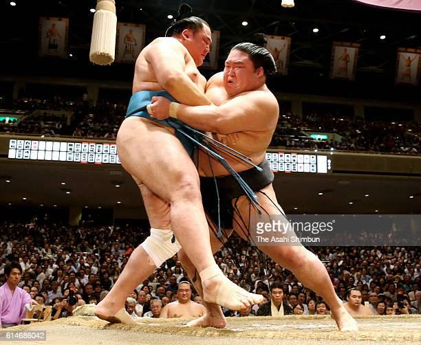 Ozeki Goeido pushes Tamawashi out of the ring to win during day fourteen of the Grand Sumo Autumn Tournament at Ryogoku Kokugikan on September 24...
