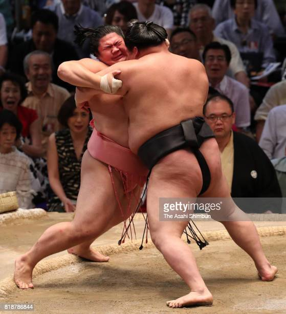 Ozeki Goeido pushes Ura out of the ring to win during day eleven of the Grand Sumo Nagoya Torunament at Aichi Prefecture Gymnasium on July 19 2017 in...