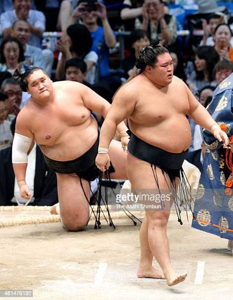 Ozeki Goeido reacts after defeating Mongolian ozeki Terunofuji during day seven of the Grand Sumo Nagoya Tournament at Aichi Prefecture Gymnasium on...