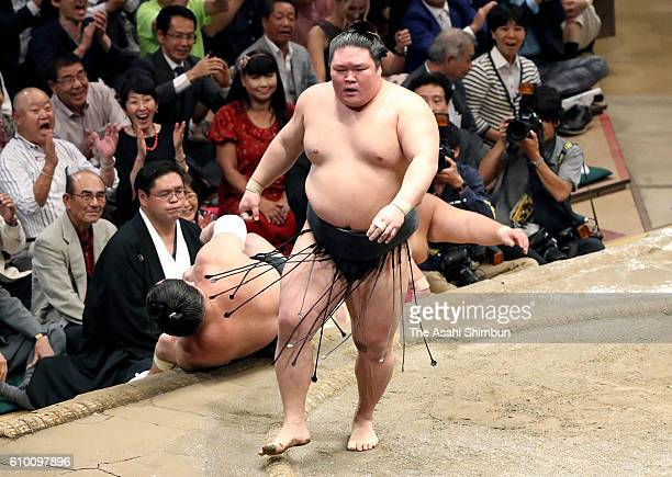 Ozeki Goeido reacts after his win over Mongolian yokozuna Harumafuji during day thirteen of the Grand Sumo Autumn Tournament at Ryogoku Kokugikan on...