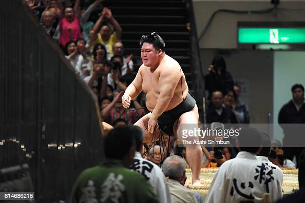 Ozeki Goeido reacts after winning the tournament after beating Tamawashi in his bout during day fourteen of the Grand Sumo Autumn Tournament at...