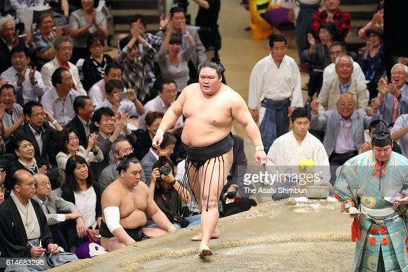 Ozeki Goeido reacts after winning the tournament after his bout against Tamawashi during day fourteen of the Grand Sumo Autumn Tournament at Ryogoku...