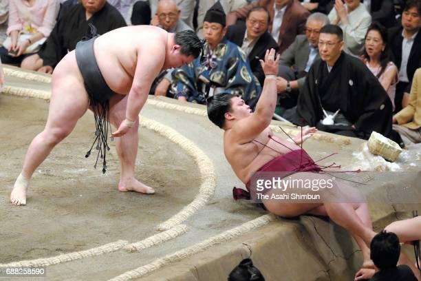 Ozeki Goeido throws komusubi Mitakeumi to win during day six of the Grand Sumo Summer Tournament at Ryogoku Kokugikan on May 19 2017 in Tokyo Japan