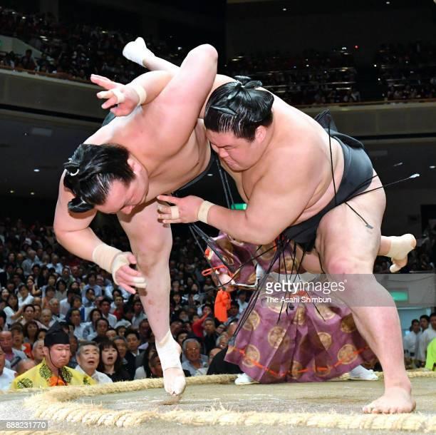 Ozeki Goeido throws Mongolian wrestler Chiyoshoma to win during day ten of the Grand Sumo Summer Tournament at Ryogoku Kokugikan on May 23 2017 in...