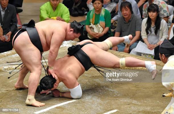 Ozeki Goeido throws Mongolian yokozuna Harumafuji to win during day fourteen of the Grand Sumo Summer Tournament at Ryogoku Kokugikan on May 27 2017...