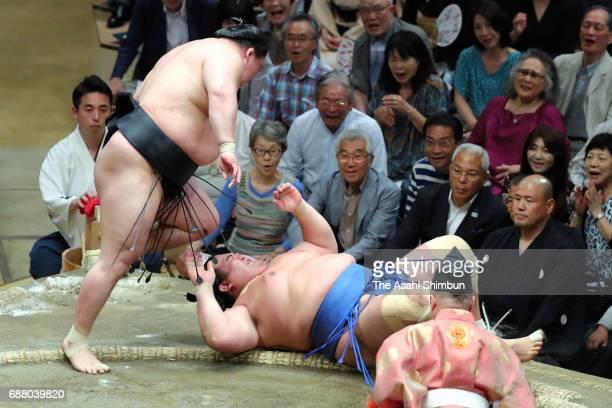 Ozeki Goeido throws sekiwake Kotoshogiku to win during day seven of the Grand Sumo Summer Tournament at Ryogoku Kokugikan on May 20 2017 in Tokyo...