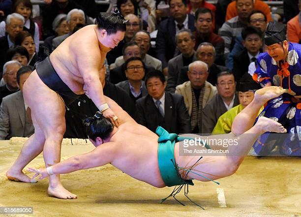 Ozeki Goeido throws Yoshikaze to win during day three of the Grand Sumo Spring Tournament at the Edion Arena Osaka on March 15 2016 in Osaka Japan
