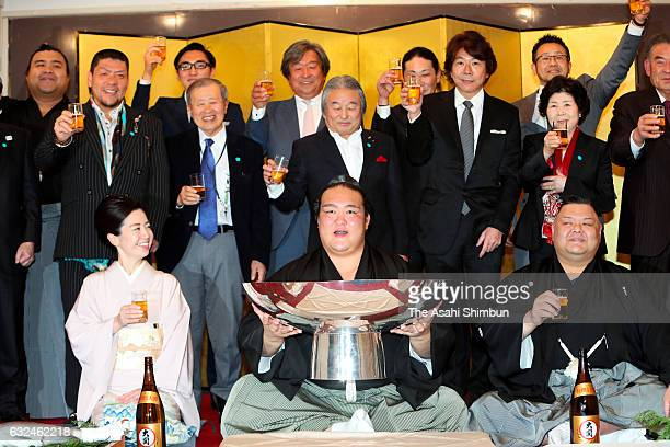 Ozeki Kisenosato celebrates winning the tournament with stable master Tagonoura and supporters at a celebration party after day fifteen of the Grand...