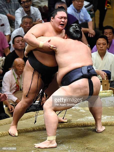 Ozeki Kisenosato pushes ozeki Goeido out of the ring to win during day fifteen of the Grand Sumo Autumn Tournament at Ryogoku Kokugikan on September...