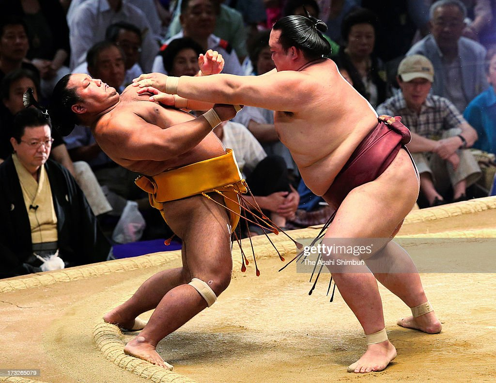 Ozeki Kisenosato (R) pushes Shohozan to win during day four of the Grand Sumo Nagoya Tournament at Aichi Prefecture Gymnasium on July 10, 2013 in Nagoya, Aichi, Japan.