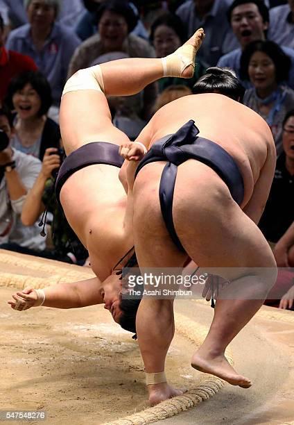 Ozeki Kisenosato throws Myogiryu to win during day six of the Grand Sumo Nagoya Tournament at the Aichi Prefecture Gymnasium on July 15 2016 in...