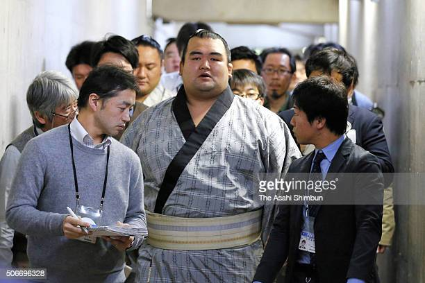 Ozeki Kotoshigiku is surrounded by media reporters during day fourteen of the Grand Sumo New Year Tournament at Ryogoku Kokugikan on January 23 2016...