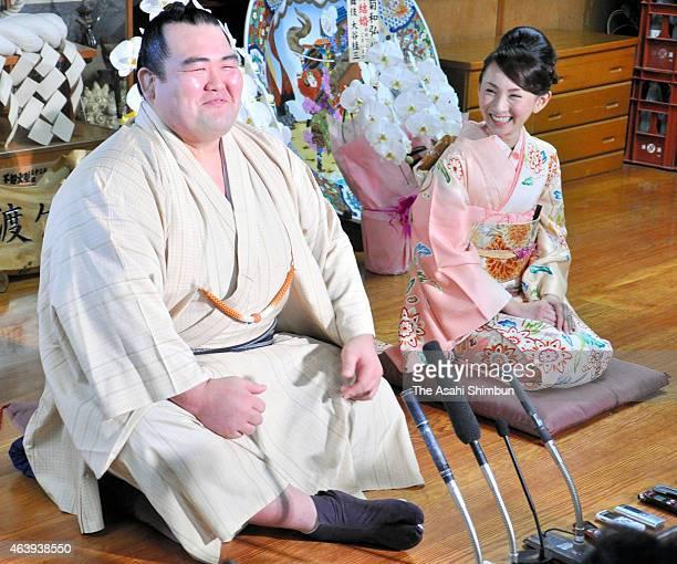 Ozeki Kotoshogiku and his fiancee Yumi Ishida attend a press conference at Sadogatake Stable on February 16 2015 in Matsudo Chiba Japan