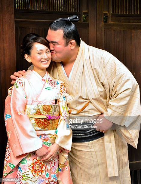 Ozeki Kotoshogiku kisses his fiancee Yumi Ishida at Sadogatake Stable on February 16 2015 in Matsudo Chiba Japan