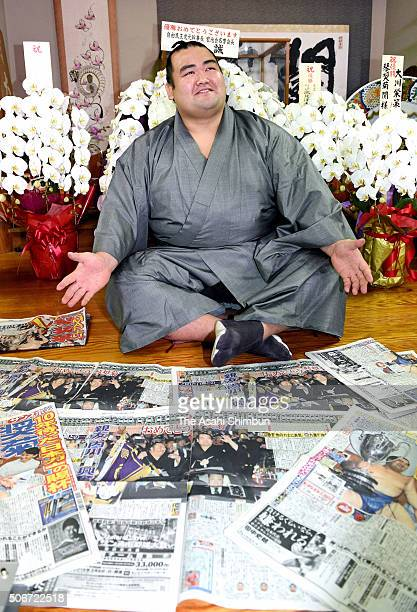 Ozeki Kotoshogiku poses for photographs during a press conference a day after winning the Grand Sumo New Year Tournament at Sadogatake Stable on...