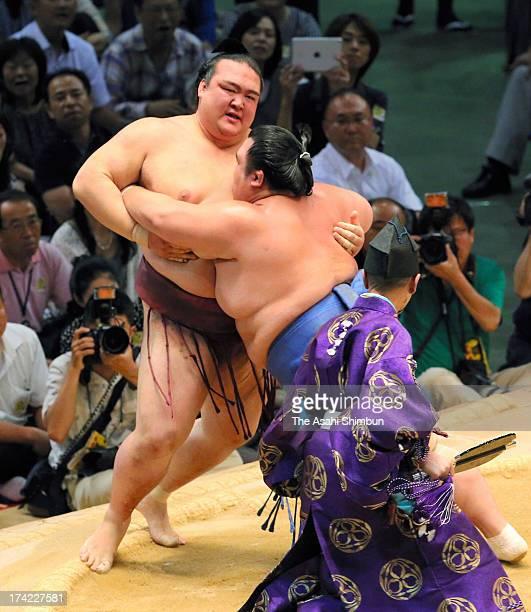 Ozeki Kotoshogiku pushes fellow ozeki Kisenosato out of the ring during day fifteen of the Grand Sumo Nagoya Tournament at Aichi Prefecture Gymnasium...