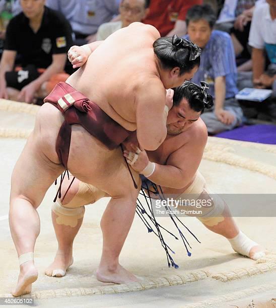 Ozeki Kotoshogiku pushes out ozeki Kisenosato to win during day ten of the Grand Sumo Nagoya Tournament at Aichi Prefecture Gymnasium on July 22 2014...