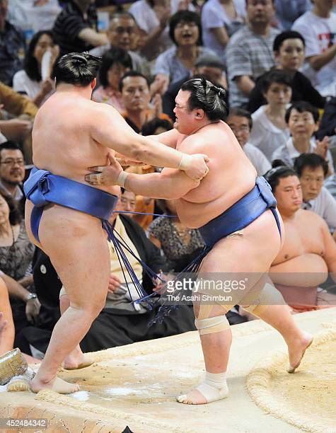Ozeki Kotoshogiku pushes out Tamawashi to win during day eight of the Grand Sumo Nagoya Tournament at Aichi Prefecture Gymnasium on July 20 2014 in...