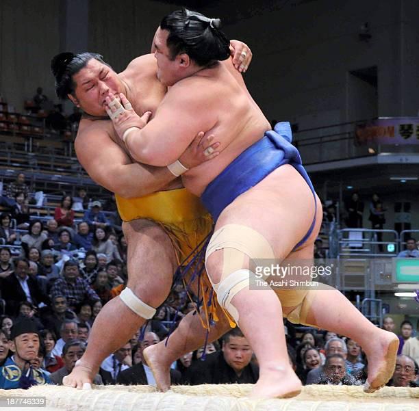 Ozeki Kotoshogiku pushes Shohozan out of the ring during day two of the Grand Sumo Kyushu Tournament at Fukuoka Convention Center on November 11 2013...