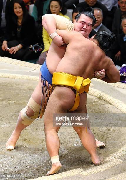 Ozeki Kotoshogiku pushes Shohozan out of the ring to win during day eleven of the Grand Sumo New Year Tournament at Ryogoku Kokugikan on January 22...