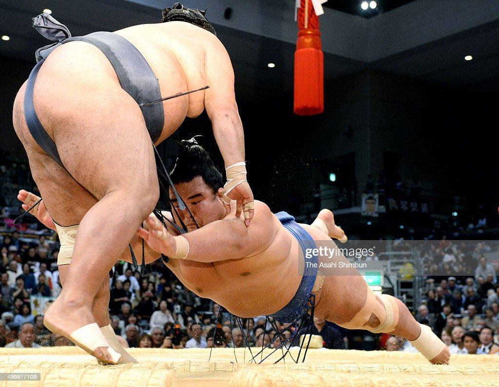 Ozeki Kotoshogiku pushes Toyonoshima out of the ring to win during day five of the Grand Sumo Kyushu Tournament at Fukuoka Convention Center on...
