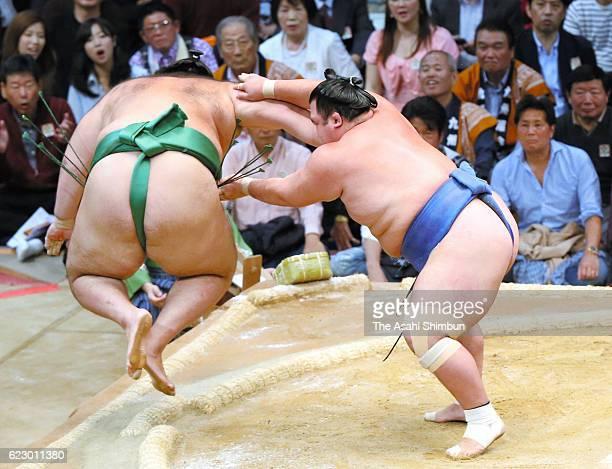 Ozeki Kotoshogiku throws Brazilian wrestler Kaisei to win during day one of the Grand Sumo Kyushu Tournament at Fukuoka Convention Center on November...