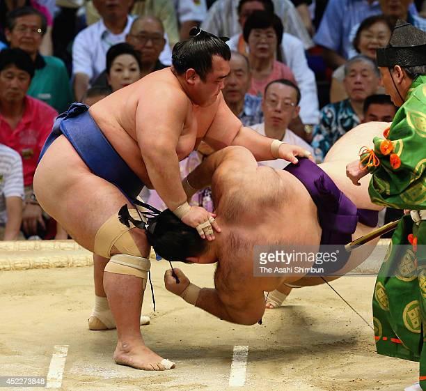 Ozeki Kotoshogiku throws Kaisei to win during day four of the Grand Sumo Nagoya Tournament at Aichi Prefecture Gymnasium on July 16 2014 in Nagoya...