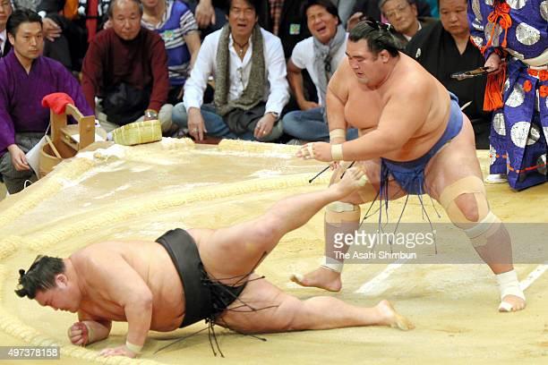 Ozeki Kotoshogiku throws ozeki Goeido to win during day seven of the Grand Sumo Kyushu Tournament at Fukuoka Convention Center on November 14 2015 in...