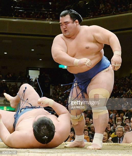 Ozeki or champion Kotoshogiku throws down fellow ozekiranked wrestler Goeido during their final bout in the New Year Grand Sumo tournament in Tokyo...