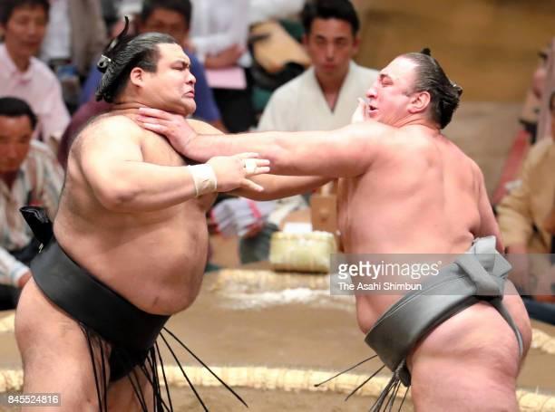 Ozeki Takayasu and Georgian wrestler Tochinoshin compete in their bout during day one of the Grand Sumo Autumn Tournament at Ryogoku Kokugikan on...