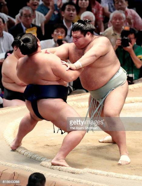 Ozeki Takayasu pushes Mitakeumi out of the ring to win during day four of the Grand Sumo Nagoya Torunament at Aichi Prefecture Gymnasium on July 12...