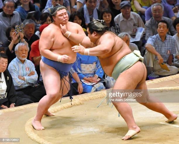Ozeki Takayasu pushes Shodai out of the ring to win during day seven of the Grand Sumo Nagoya Torunament at Aichi Prefecture Gymnasium on July 15...