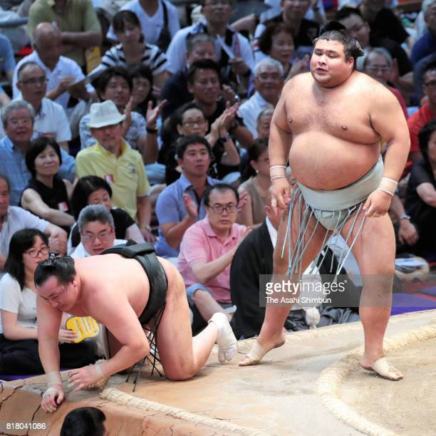 Ozeki Takayasu reacts after his victory over Mongolian wrestler Chiyoshoma during day eight of the Grand Sumo Nagoya Torunament at Aichi Prefecture...
