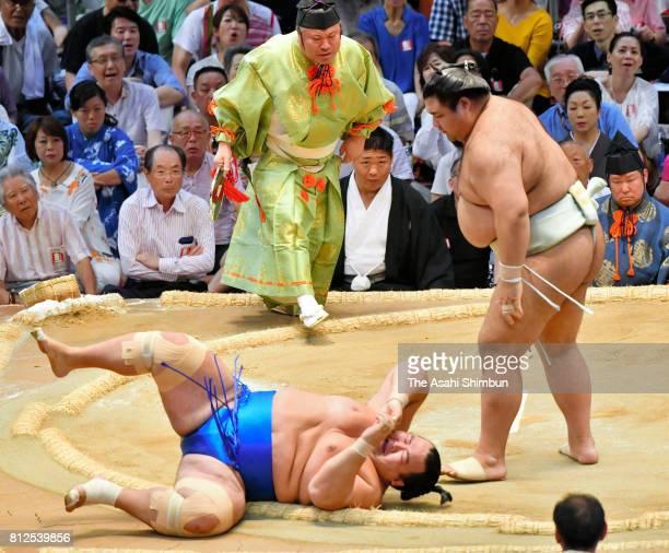 Ozeki Takayasu throws komusubi Kotoshogiku to win during day three of the Grand Sumo Nagoya Torunament at Aichi Prefecture Gymnasium on July 11 2017...