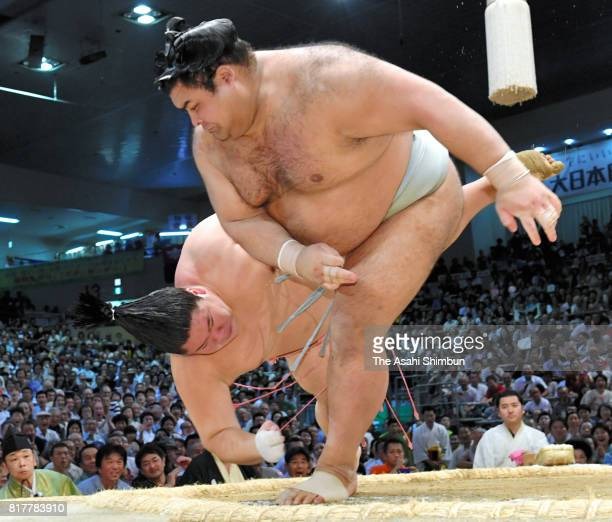 Ozeki Takayasu throws Ura to win during day ten of the Grand Sumo Nagoya Torunament at Aichi Prefecture Gymnasium on July 18 2017 in Nagoya Aichi...