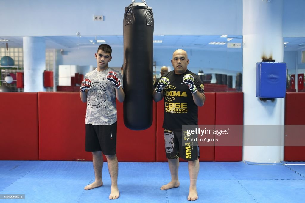 Ozlen Alkac (45), an MMA fighter poses for a photo with his 17-year-old MMA fighter son Alim Can Alkac, who had chosen the same field of profession with his father following his lead, in Ankara, Turkey on June 16, 2017. Fathers, sometimes shape the future of their children directing their career and profession choices.