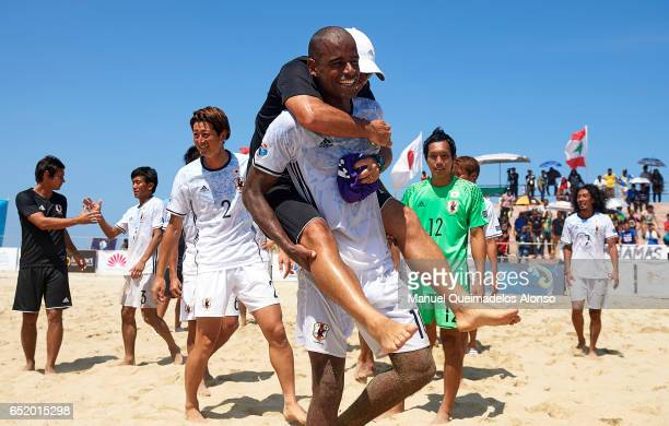 Ozu Moreira of Japan celebrates after winning with his manager Marcelo Mendes during day seven of the AFC Beach Soccer Championship 2017 match...