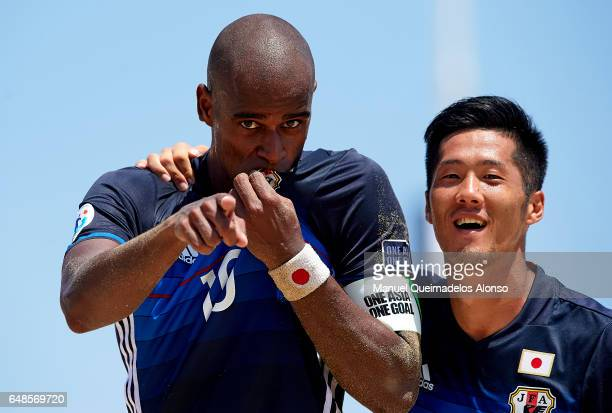 Ozu Moreira of Japan celebrates scoring with his teammate Takaaki Oba during day three of the AFC Beach Soccer Championship 2017 match between Japan...