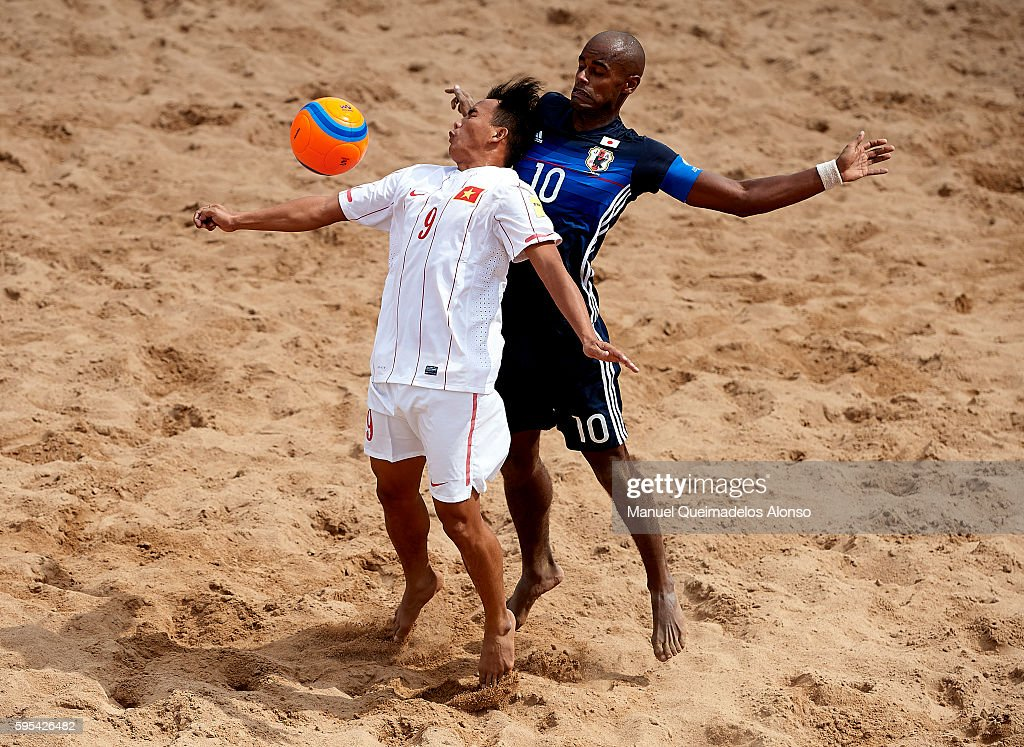 Ozu Moreira (R) of Japan competes for the ball with Train Vinh Phong of Vietnam during the Continental Beach Soccer Tournament match between Japan and Vietnam at Municipal Sports Center on August 25, 2016 in Ordos of Inner Mongolia Autonomous Region, China.