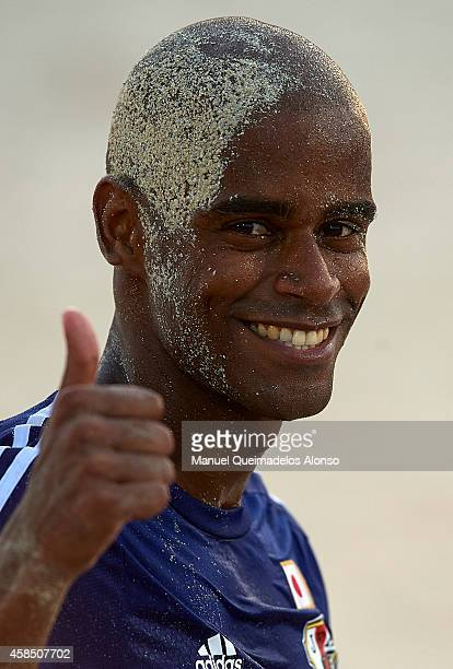 Ozu Moreira of Japan greet the fans after day three of the Beach Soccer Intercontinental Cup 2014 match between Japan and USA at Dubai International...